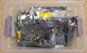 Plastic tub containing lots of PC expansion cards in anti-static bags.